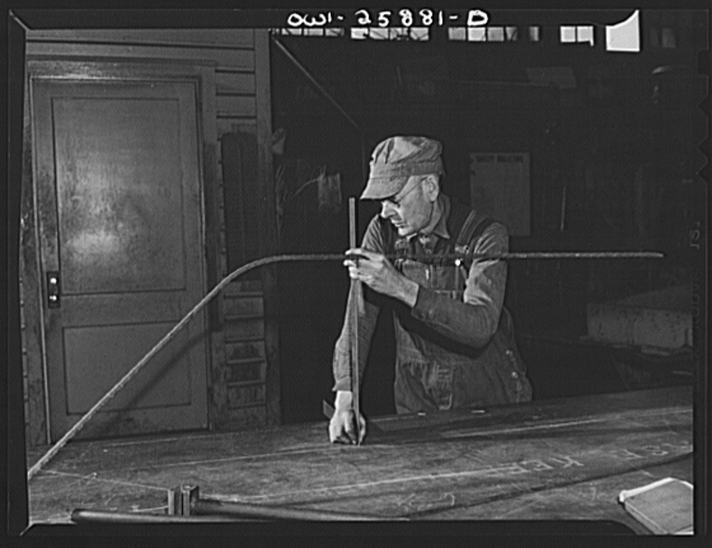 Bethlehem-Fairfield shipyards, Baltimore, Maryland. Forming a master pattern for pipe bending