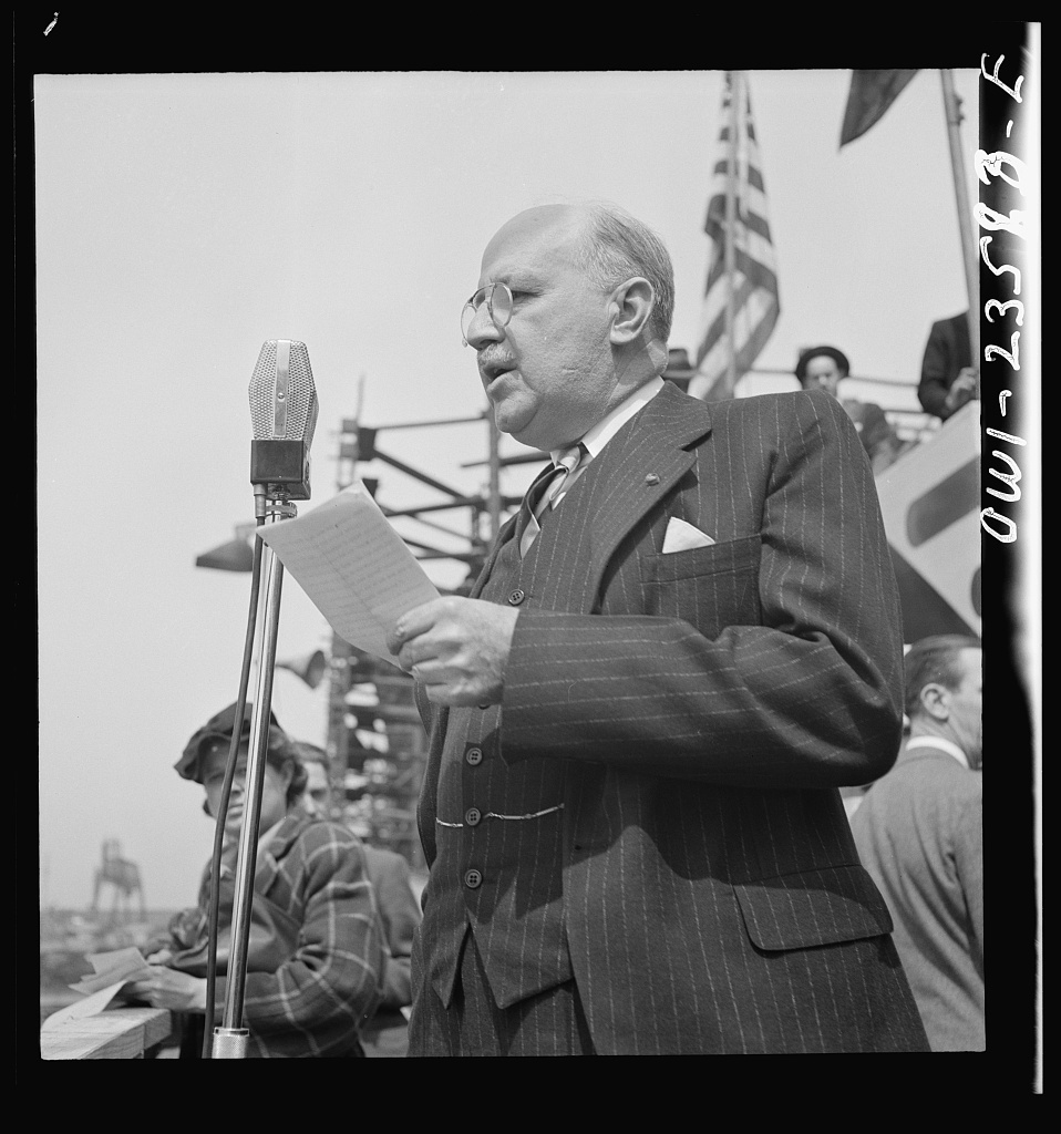 Bethlehem-Fairfield shipyards, Baltimore, Maryland. Guest speaker, a representative of the Maritime Commission, at a launching ceremony
