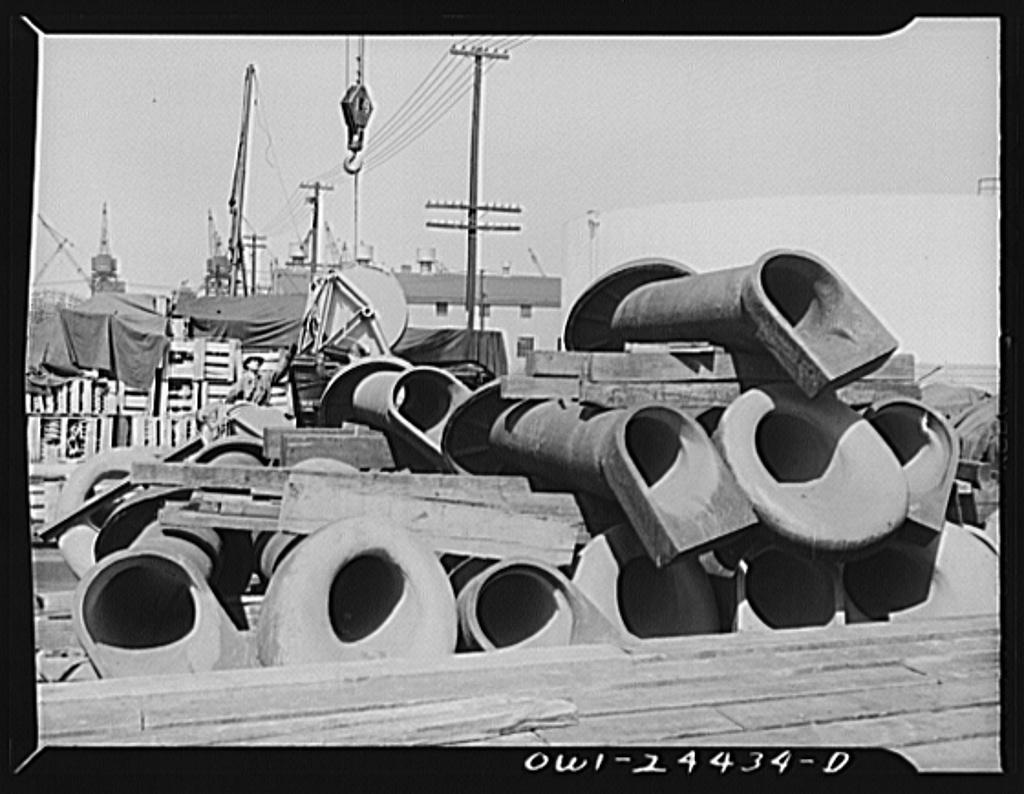 Bethlehem-Fairfield shipyards, Baltimore, Maryland. Hawse pipes in storage