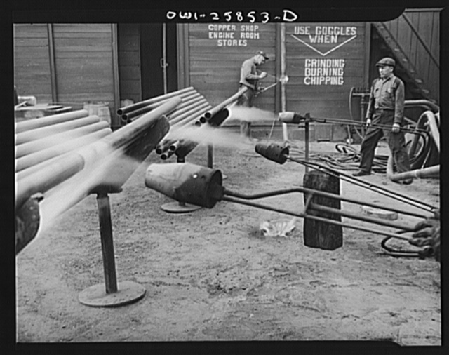 Bethlehem-Fairfield shipyards, Baltimore, Maryland. Heating pipe with a flame thrower