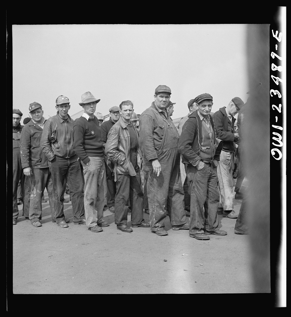 Bethlehem-Fairfield shipyards, Baltimore, Maryland. Lining up before a time clock