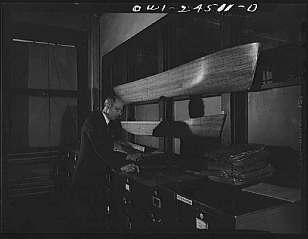 Bethlehem-Fairfield shipyards, Baltimore, Maryland. Looking at blueprints of the ship model