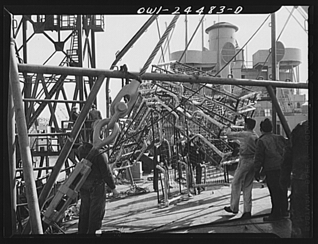 Bethlehem-Fairfield shipyards, Baltimore, Maryland. Lowering berthing to the deck of a vessel