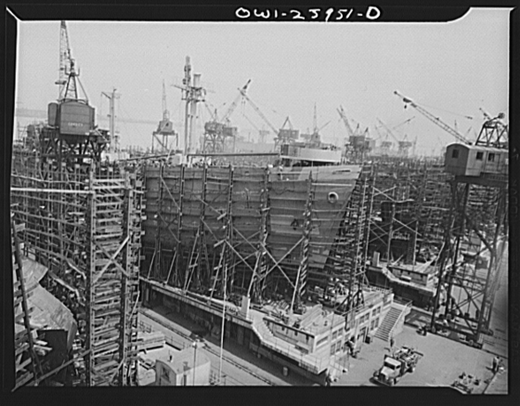Bethlehem-Fairfield shipyards, Baltimore, Maryland. Painting the sides of a nearly finished ship