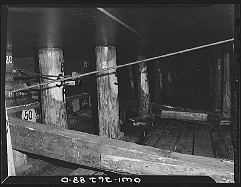 Bethlehem-Fairfield shipyards, Baltimore, Maryland. Preparations for launching a ship. Poppins underneath the ship