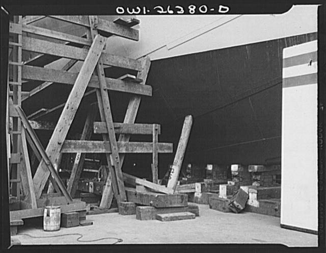 Bethlehem-Fairfield shipyards, Baltimore, Maryland. Preparations for launching a ship. Keel blocks in forward part of the ship