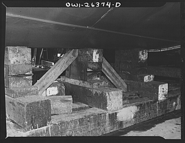 Bethlehem-Fairfield shipyards, Baltimore, Maryland. Preparations for launching a ship. Keel blocks underneath the ship