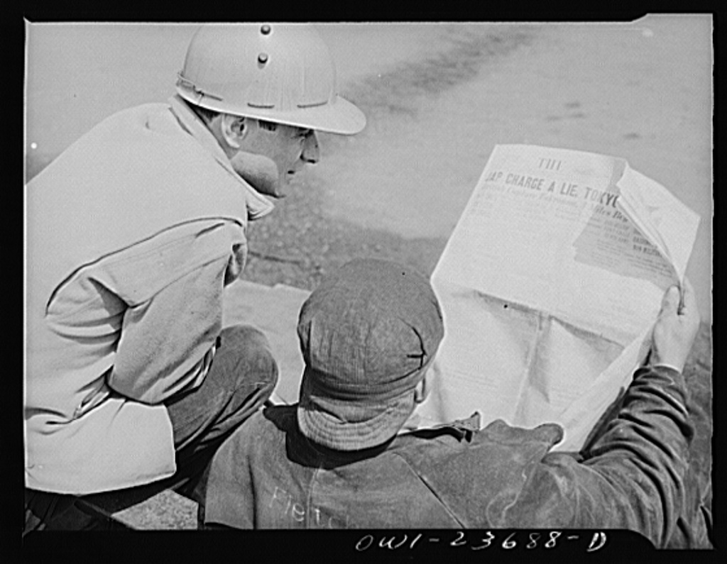 Bethlehem-Fairfield shipyards, Baltimore, Maryland. Reading the Baltimore Sun during lunch time
