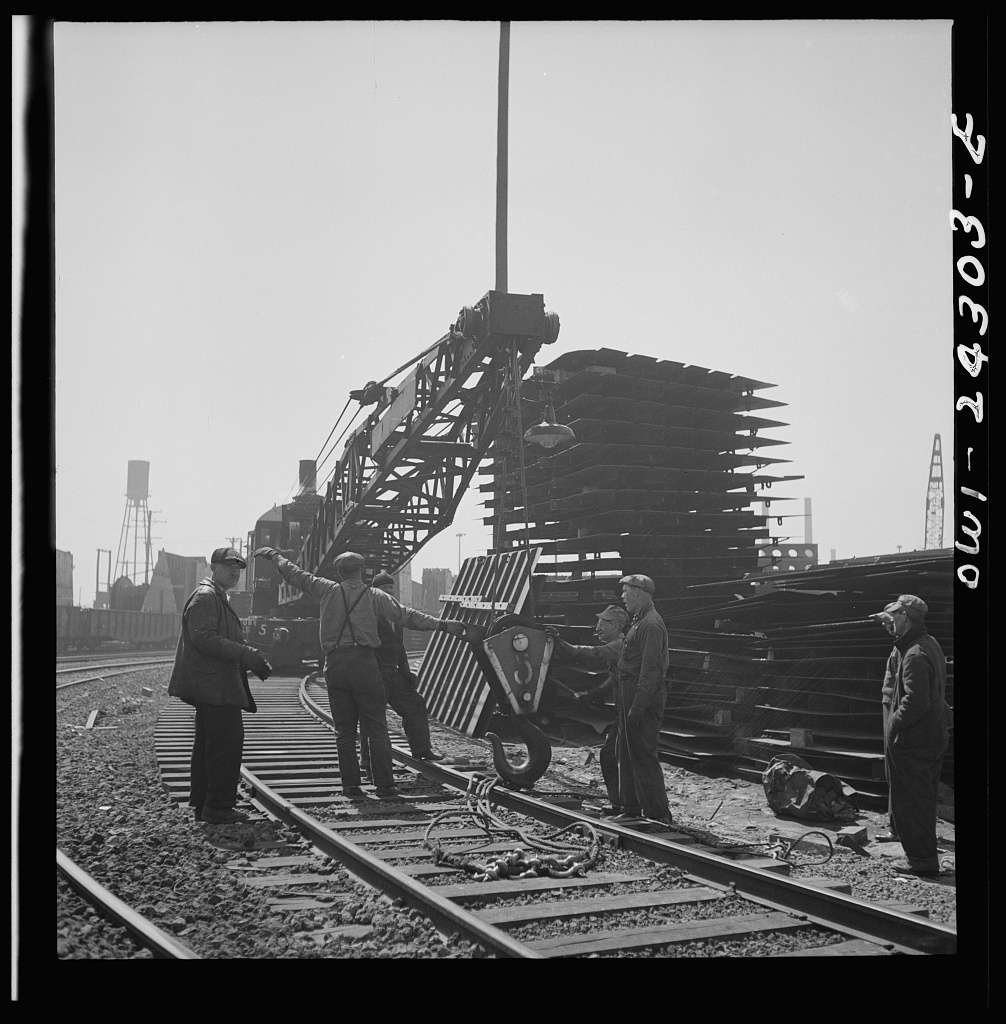 Bethlehem-Fairfield shipyards, Baltimore, Maryland. Steam crane operating in a stockyard