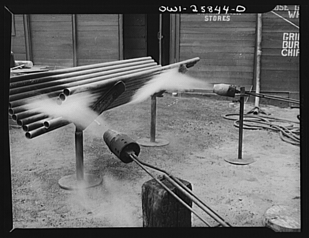 Bethlehem-Fairfield shipyards, Baltimore, Maryland. Testing pipes with flame throwers