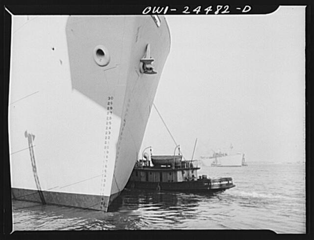 Bethlehem-Fairfield shipyards, Baltimore, Maryland. Tugs shifting Liberty ships