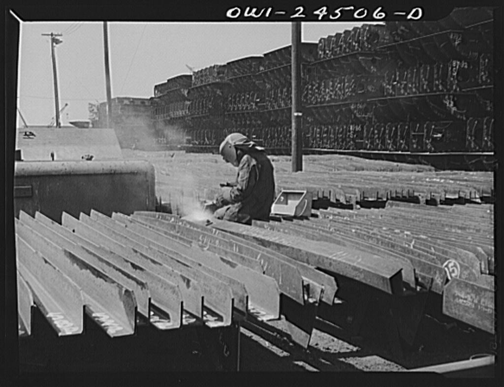 Bethlehem-Fairfield shipyards, Baltimore, Maryland. Welding brackets to a shell frame