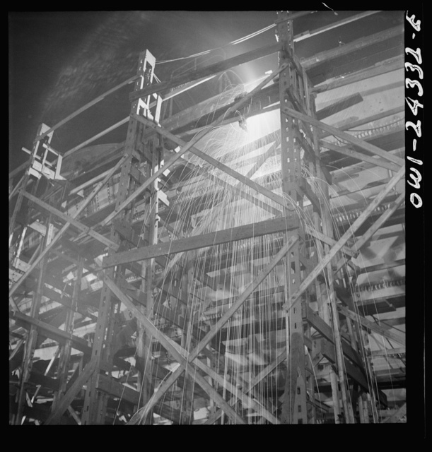 Bethlehem-Fairfield shipyards, Baltimore, Maryland. Welding on the shell of a ship