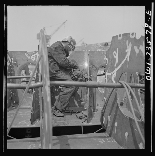 Bethlehem-Fairfield shipyards, Baltimore, Maryland. Welding the floor to a vertical keel