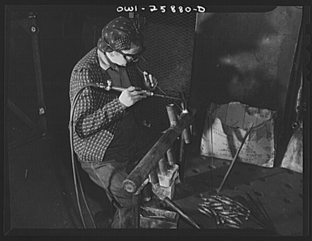 Bethlehem-Fairfield shipyards, Baltimore, Maryland. Woman welder attaching pipe angles