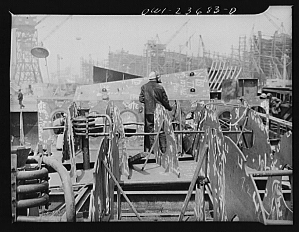 Bethlehem-Fairfield shipyards, Baltimore, Maryland. Working in an inner bottom section