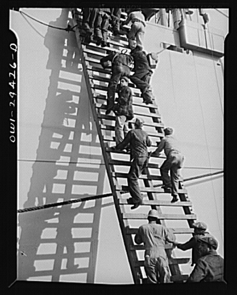 Bethlehem-Fairfield shipyards, Baltimore, Maryland. Workmen boarding a ship