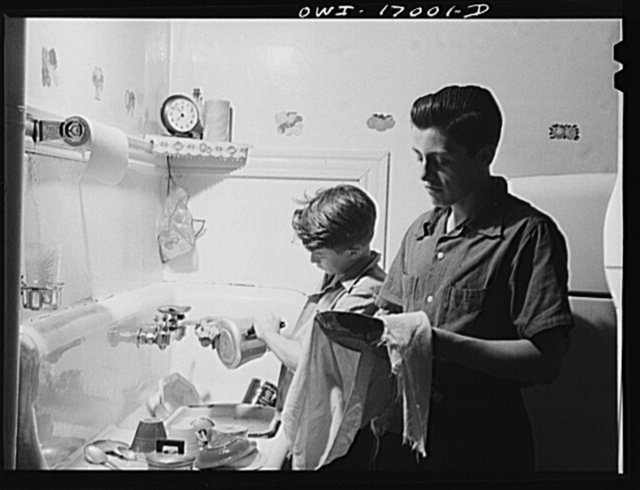 Blue Island, Illinois. Bobby and Jerry Senise doing the dishes while their mother has gone off to help with the Red Cross canteen