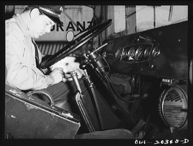Bob Daugherty, a driver for the Associated Transport Company, working on his log book after stopping for coffee. Interstate Commerce Commission regulations require time records from all truck drivers