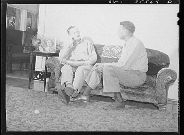 Bowman, South Carolina. Sergeant John Riley of the 25th service group, Air Service Command, at home on leave talking things over with his father