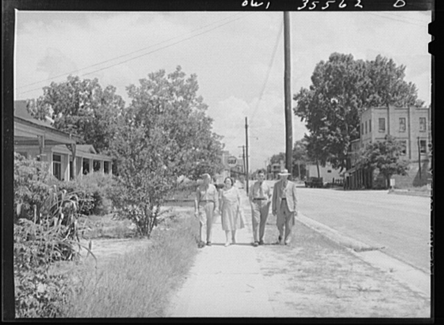 Bowman, South Carolina. Sergeant John Riley of the 25th service group, Air Service Command, on leave at home, coming out of church with his parents and brother