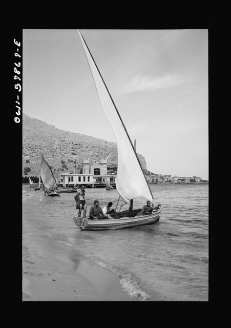 Boys with their sailboat in Sicily. The people are now seeking normal outlets for enjoyment
