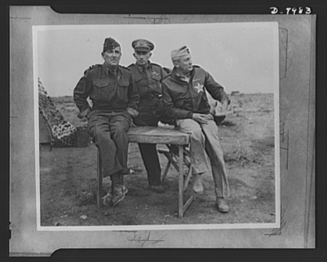 British and U.S. air chiefs in the desert. These three top-ranked United Nations flying officers were pictured together recently in the African Desert. They are (left to right) British Air Vice Marshall A. Coningham, Brigadier General Auby C. Strickland of the U.S. Air Force and Lieutenant General Frank M. Andrews, commander of the U.S. Army forces in the Middle East and himself a flyer