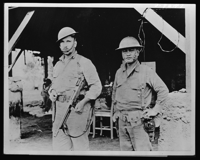 Brothers in arms. Typical of the 10,000 Americans who helped to stall Japan's forces on Bataan was Captain Arthur W. Wermuth (left) shown here with his Filipino aide. During the four months of fighting in Bataan, Captain Wermuth and his aide accounted for over a hundred of the enemy