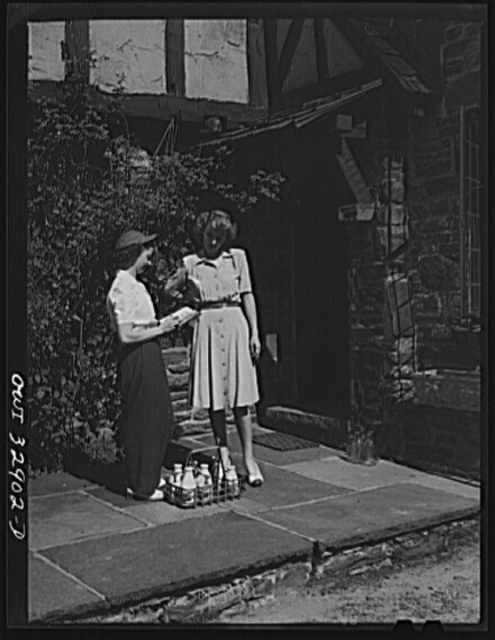Bryn Mawr, Pennsylvania. Mrs. Helen Joyce, one of the many women now working for the Supplee-Wills-Jones Milk Company. She is making her rounds collecting bills