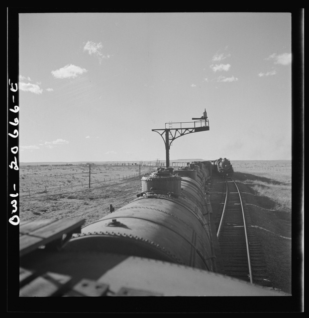 Buchanan, New Mexico. Passing an eastbound freight along the Atchison, Topeka, and Santa Fe Railroad between Clovis and Vaughn, New Mexico
