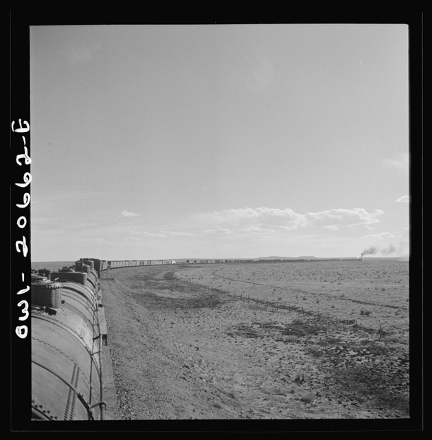 Buchanan, New Mexico. Rounding a long curve approaching the town along the Atchison, Topeka, and Santa Fe Railroad between Clovis and Vaughn, New Mexico