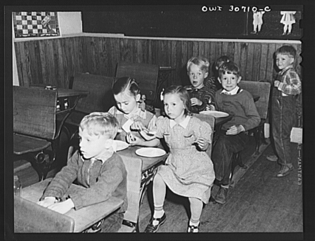 Buffalo Hill, Aroostook County, Maine. Younger members of the congregation eat cookies, flavorade and homemade wild strawberry ice cream, refreshments served in the social period following a Congregational church service held in a one-room rural school house