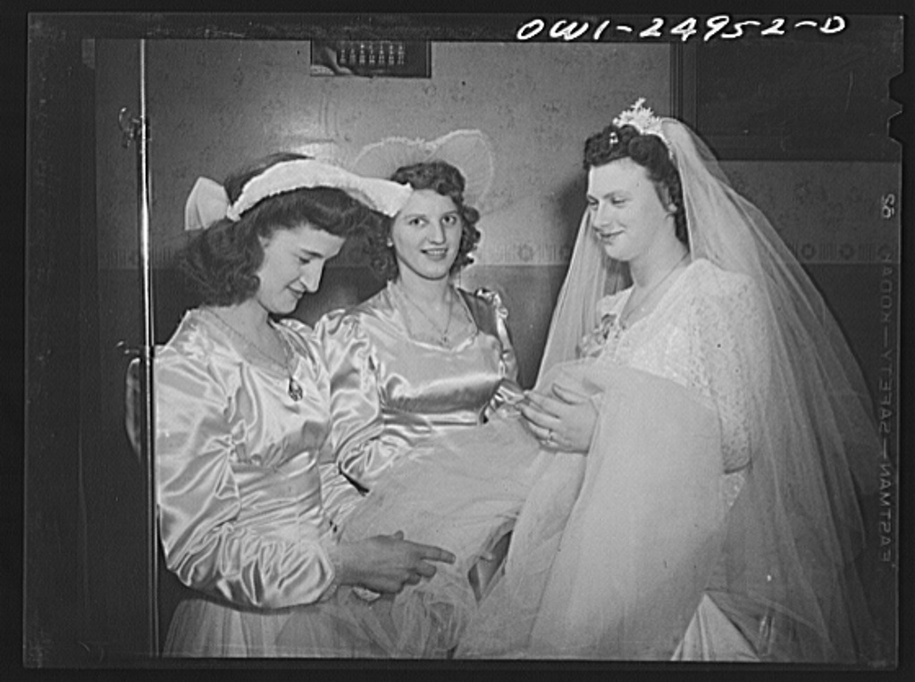 Buffalo, New York. At the wedding of Cedelia Wrazen and Bronislaus Nowak, who are of Polish descent. They are employed at Ross Heater, makers of condensers for the Navy. Cecelia with two of her bridesmaids