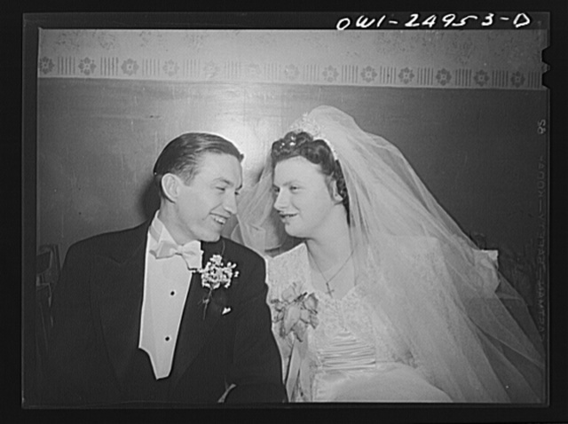 Buffalo, New York. At the wedding of Cedelia Wrazen and Bronislaus Nowak, who are of Polish descent. They are employed at Ross Heater, makers of condensers for the Navy. He is temporarily deferred from the Army due to essential work. They apologized for the smallness of the wedding, blamed it on rationing of food, talked of how their parents' weddings had lasted for four days of feasting