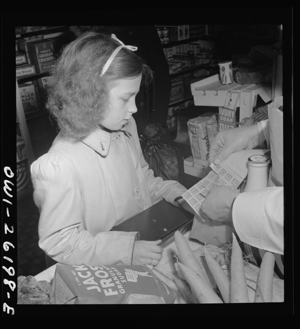 Buffalo, New York. Beverly Ann Grimm, eleven, leaving the store after making the family purchases from a list left that morning by her twenty-six year old widowed mother who is a crane operator at Pratt and Letchworth. Here she submits ration coupons to the grocer for what she has purchased
