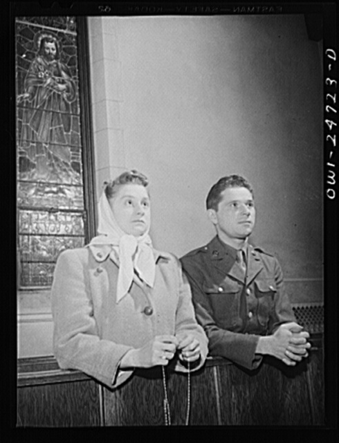Buffalo, New York. Frank and Laura Czaya praying in church one week after Easter. They were married six months before Frank was drafted. He is now a corporal, stationed in Arkansas and is home on a ten day furlough. Laura works in the Symington-Gould plant; lives in an apartment with her family in Depew. The Czayas are of Polish descent