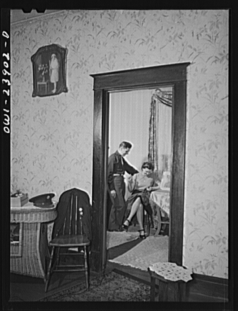 Buffalo, New York. Laura and Frank Czaya, a couple of Polish descent, in the bedroom of the home which they share with Laura's mother, aunt, and brother, in Depew. Frank is home on a ten-day furlough. Laura works in the nearby Symington-Gould plant
