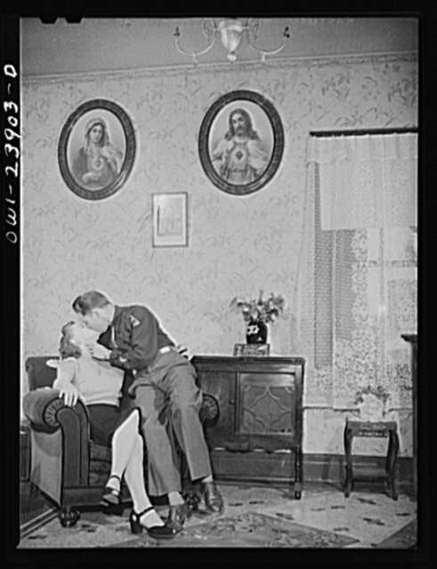 Buffalo, New York. Laura and Frank Czaya, a couple of Polish descent, in the living room of the home which they share with Laura's mother, aunt, and brother, in Depew. Frank is home on a ten-day furlough. Laura works in the nearby Symington-Gould plant