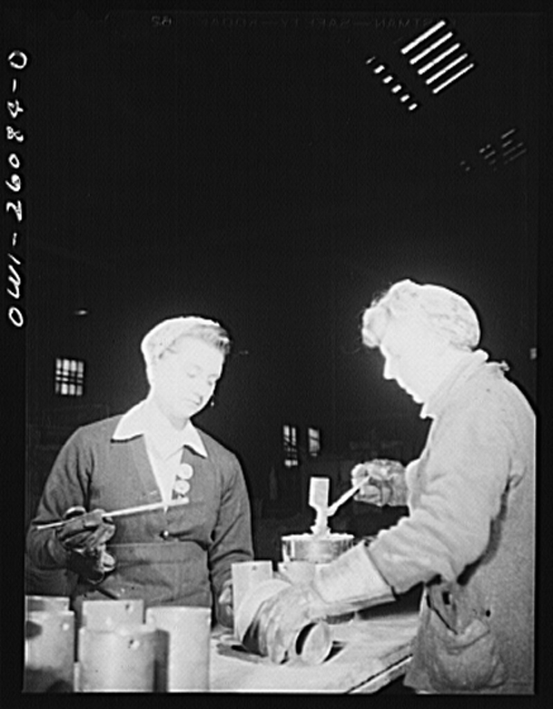 Buffalo, New York. Laura Czaya painting snubbers, a part of railroad car couplers at Symington-Gould. She is of Polish descent and formerly worked at Gould Battery. Previously she was forelady of a WPA (Work Projects Administration) sewing project. Her husband is in the Army