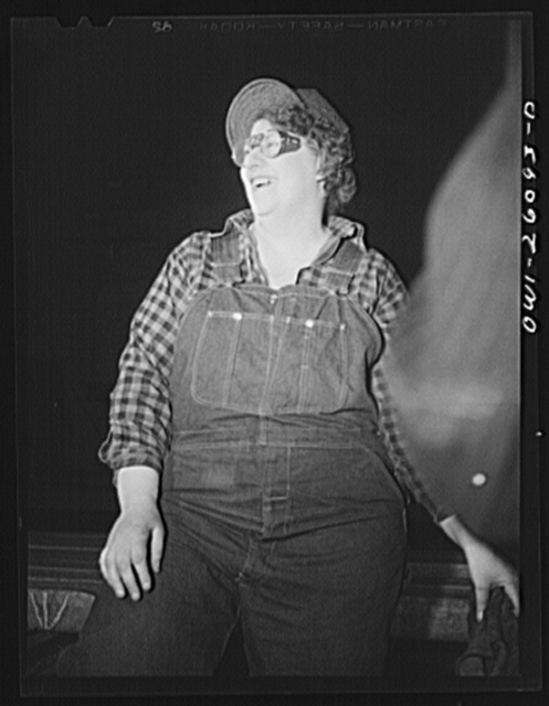 "Buffalo, New York. Mrs. Frances O'Neil, a ""hooker,"" has been with Republic Steel since December, 1942. Hookers place slings and chains around material to be hoisted by the crane"