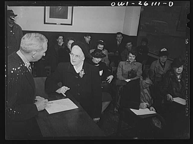 Buffalo, New York. People waiting to be interviewed at the employment agency of the Bell Aircraft plant. This woman is forty-five, and worked in a factory in the last war; has since been a housewife, and has two children over fourteen