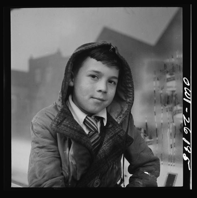Buffalo, New York. Peter Grimm, age ten, waiting with his wagon outside Loblaw's grocery store for customers to ask him to deliver their groceries. This was a rainy day with few customers. Sometimes Peter makes as much as three dollars on a Saturday. He pays for all his school supplies and much of his clothing. His mother, a twenty-six year old widow, is a crane operator at Pratt and Letchworth