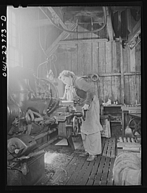 Buffalo, New York. Polish-American woman operating a lathe which finishes part of the locomotive wheel at the New York Car Wheel Company, makers of locomotive wheels for the railroads