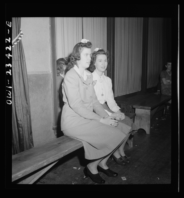 Buffalo, New York. Swingshift workers sitting on the sidelines at the weekly shift dance held from midnight to four a.m. at the Main-Utica ballroom