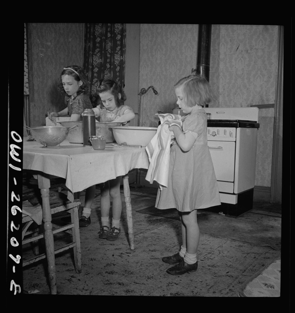 Buffalo, New York. The Grimm children doing the housework. Their mother, a twenty-six year old widow, is a crane operator at Pratt and Letchworth