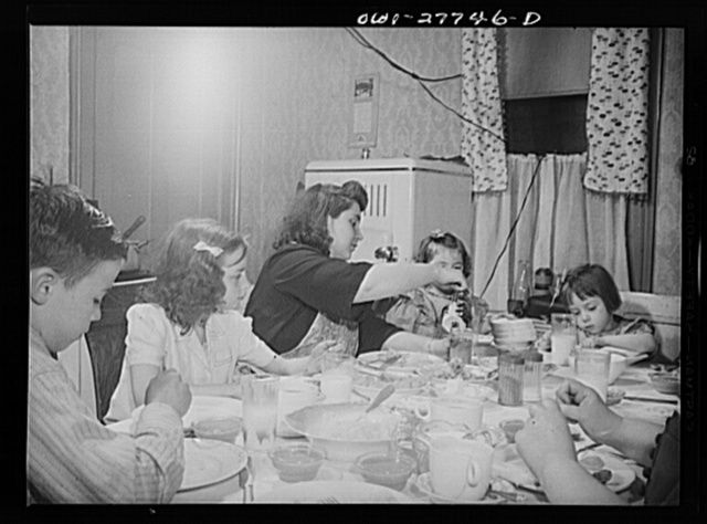 Buffalo, New York. The Grimm family eating Sunday dinner. Mrs. Grimm, a twenty-six year old widow, is a crane operator at Pratt and Letchworth. The two youngest children live in a foster home during the week
