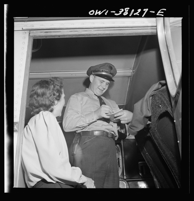 Bus trip from Knoxville, Tennessee, to Washington, D.C. Bus driver signing for manifest baggage which has been loaded on his bus. He is now responsible for it