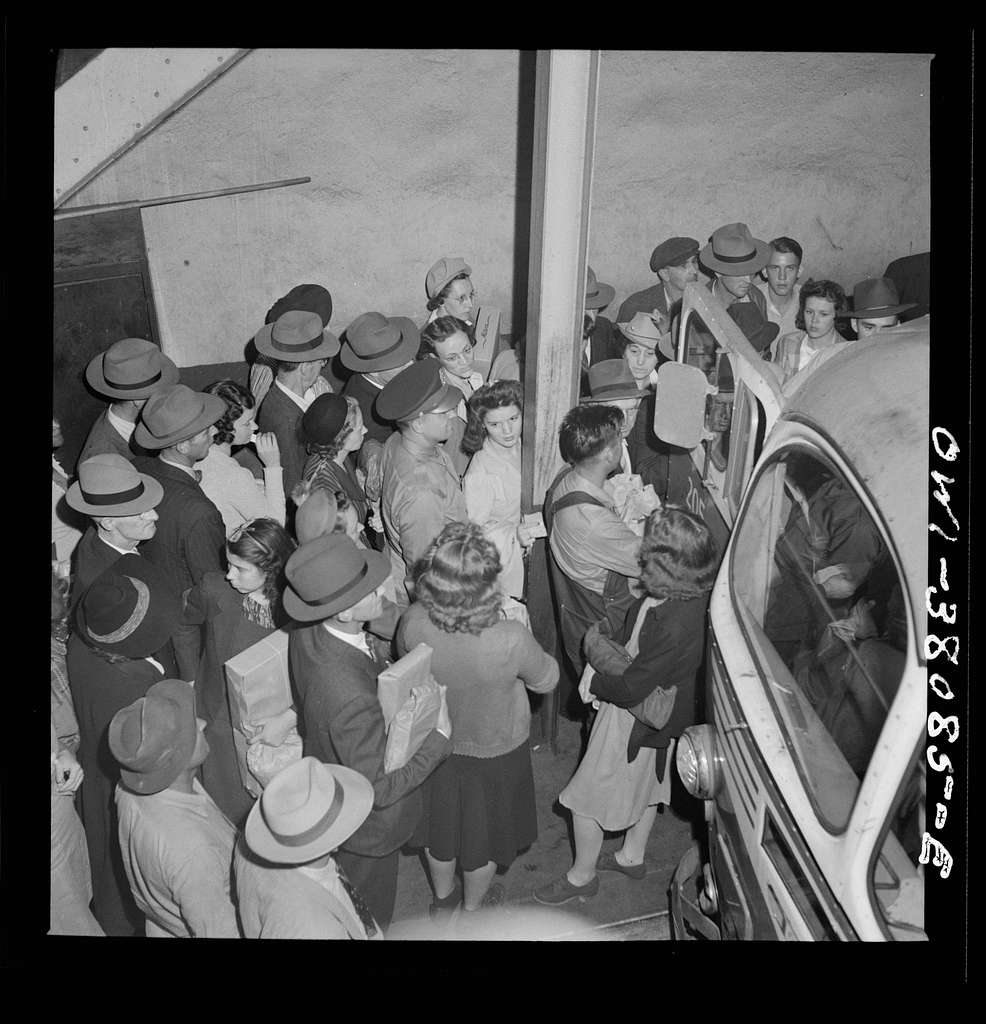 Bus trip from Knoxville, Tennessee, to Washington, D.C. Passengers boarding bus at Knoxville