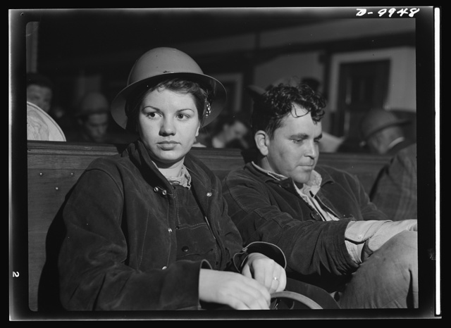 California shipyard workers. Eight hours of work in a Richmond, California shipyard find these two workers grateful for the calm and quiet of the ferry trip back to San Francisco