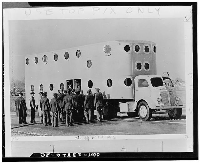 Camp Carson, Colorado. White tractor and specially designed semi-trailer which holds up to 260 soldiers is used for transportation on the camp ereservation. The bus contains 700 square feet of floor space and seats approximately 100 men. The rest ride standing up